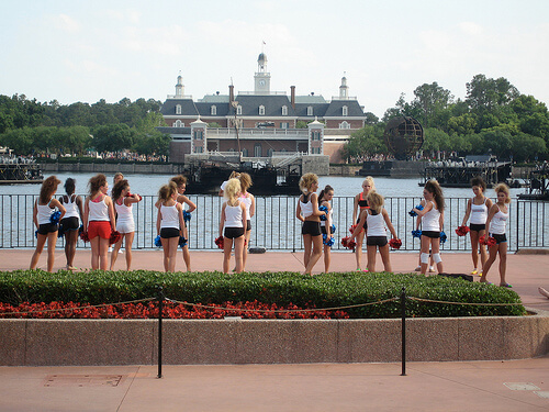 Cheerleaders practice in front of the World Showcase lagoon