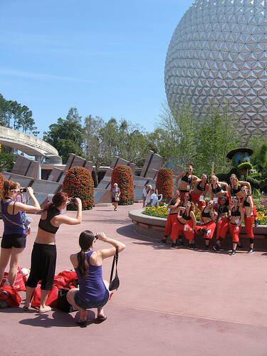 Dance team posing in front of Spaceship Earth