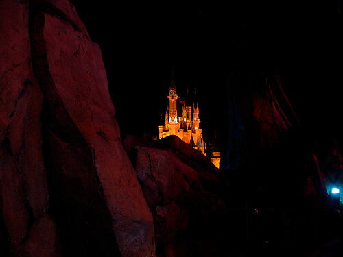 Cinderella Castle hidden behind Tomorrowland rocks