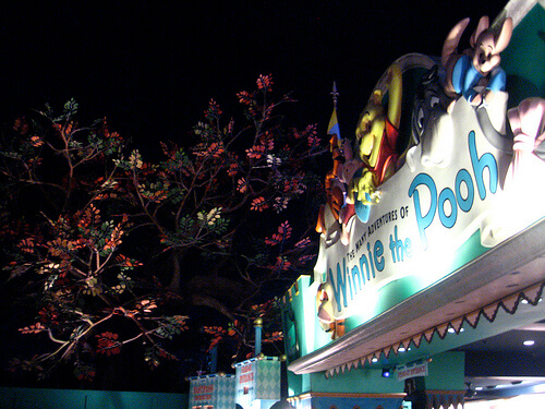 Winnie the Pooh and its newly-relocated tree at night