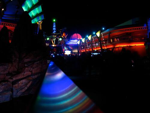 Tomorrowland railing rainbow at night