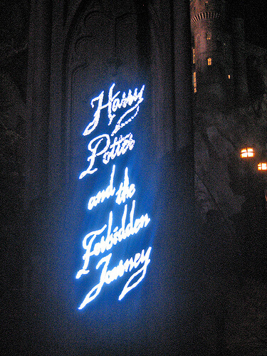 Harry Potter and the Forbidden Journey sign at night in the Wizarding World of Harry Potter