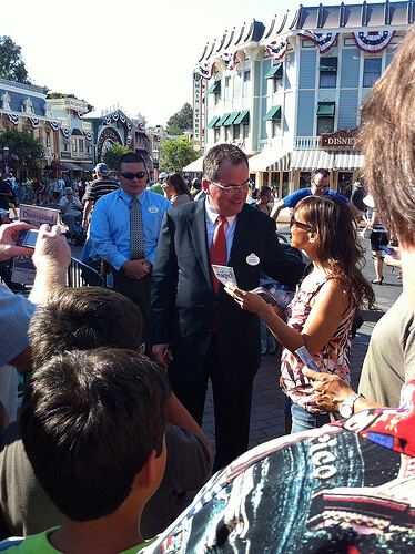 Disneyland Resort president George Kalogridis signs and autograph