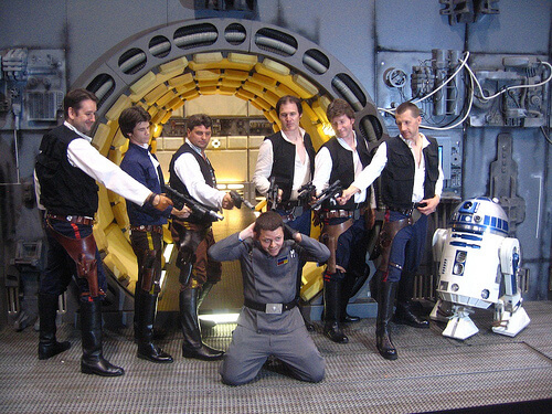 Han Solos detain Imperial officer (with R2-D2)