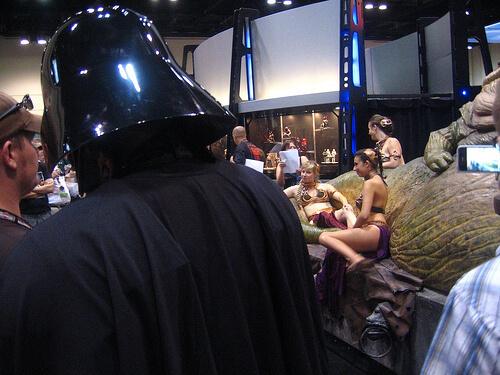 Darth Vader looks on at Slave Leias
