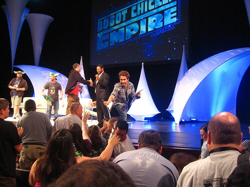 Seth Green hands out Lando masks at Robot Chicken panel