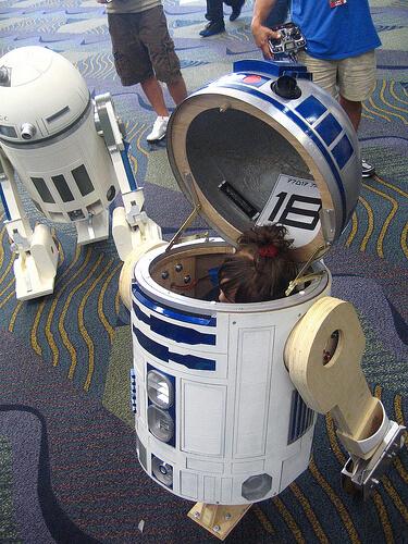 Girl resting inside R2-D2