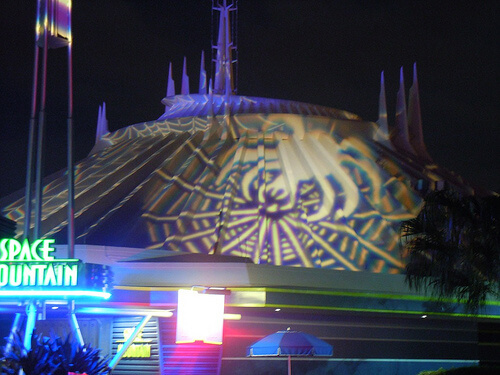 Spider and web projected onto Space Mountain