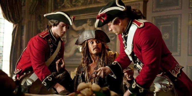 Jack Sparrow in between two other men