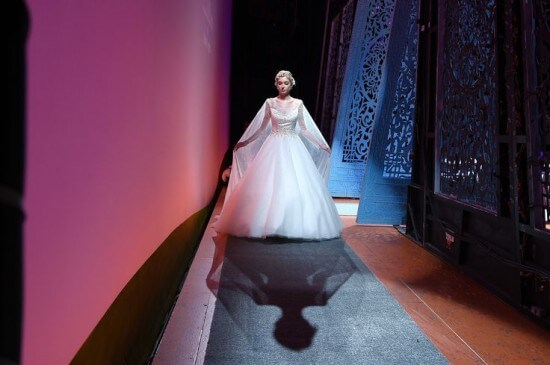 NEW YORK, NY - OCTOBER 07:  A model prepares backstage during 2016 Alfred Angelo Disney Fairy Tale Weddings Bridal Collection fashion show debut at New Amsterdam Theatre on October 7, 2015 in New York City.  (Photo by Bryan Bedder/Getty Images for Alfred Angelo)