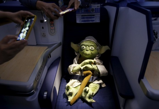 here-a-yoda-plush-toy-sits-in-the-business-section-yoda-is-a-star-wars-fan-favorite