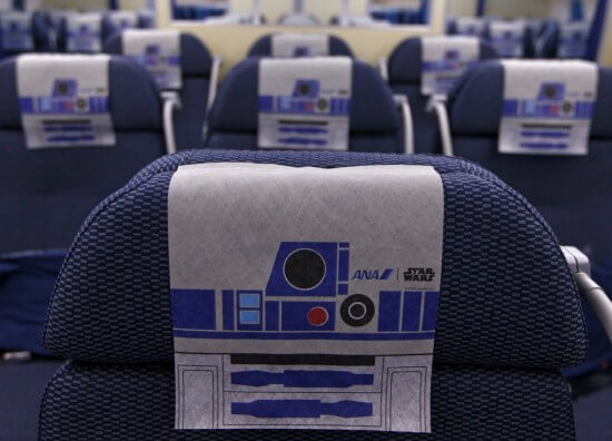 r2-d2-headrests-line-the-rows-of-seats-other-items-including-cups-and-napkins-are-also-designed-with-an-r2-d2-theme