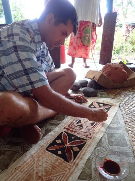 MOANA story artist, David Derrick, learns tapa painting during a research trip.