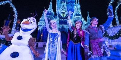 "Queen Elsa from ""Frozen"" Transforms Cinderella Castle in ""A Frozen Holiday Wish"""