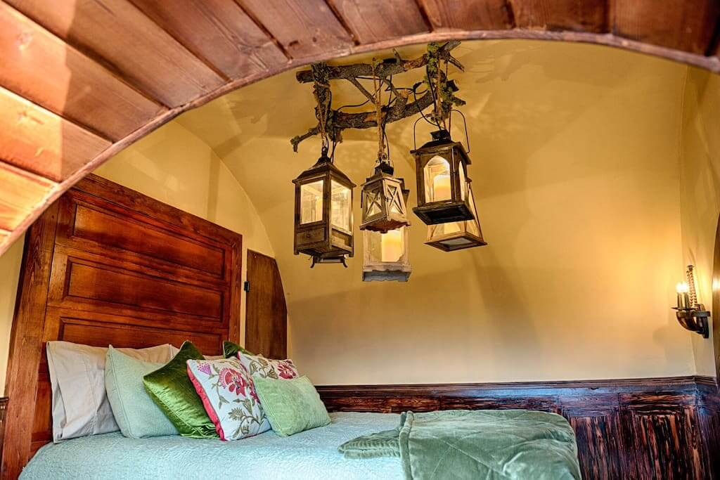 travel in style spend the night in your own hobbit hole at lord of the rings inspired airbnb. Black Bedroom Furniture Sets. Home Design Ideas