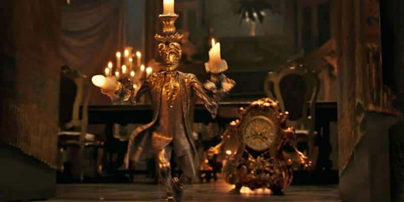 VIDEO Lumiere Cogsworth Meet Belle Prepare Dinner In Two More Preview Clips From Disneys Beauty And The Beast