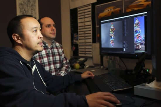 "Gus Dizon and Michael Comet work on ""Cars 3,"" as seen on March 21, 2017 at Pixar Animation Studios in Emeryville, Calif. (Photo by Deborah Coleman / Pixar)"