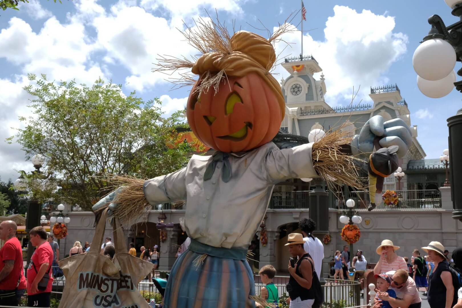 at the beginning of main street is where you can find several scarecrows posed with different props and festive outfits all of them appear welcoming and - Disney World Halloween Decorations