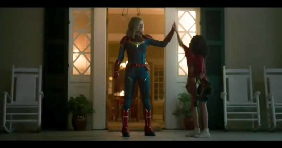 captain marvel and young monica rambeau high-fiving