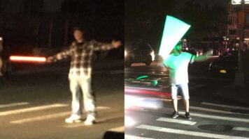 New York City Star wars fans direct traffic with lightsabers