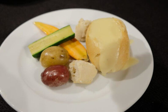 Cheese Fondue in a Bread Bowl with Fresh Steamed Baby Vegetables and Marble Potatoes