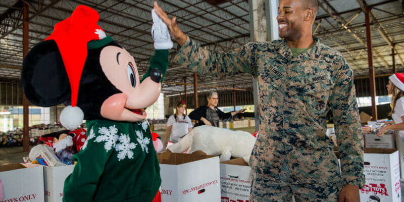 Disney Cast volunteering for toys for tots