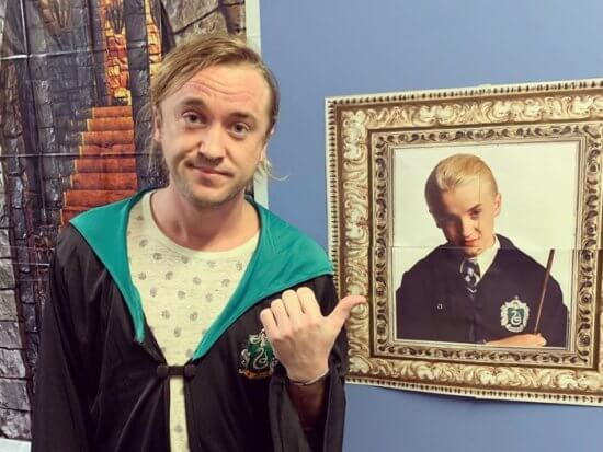 Tom Felton Posing with a picture of his younger self