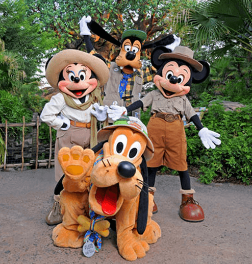 (left to right) minnie mouse, pluto, goofy, and mickey mouse at disney's animal kingdom