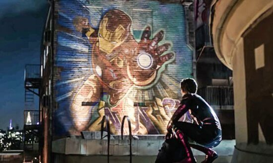 Spider-Man taking in a mural of Iron Man