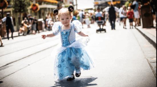 Little girl in Elsa dress on Main Street USA
