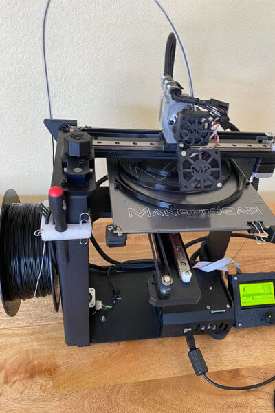 One of Universal's three 3-D printers turning out headbands