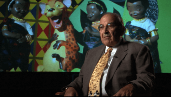 """Imagineer Marty Sklar in front animatronics from """"it's a small world"""""""
