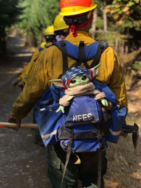 Baby Yoda with the firefighters.