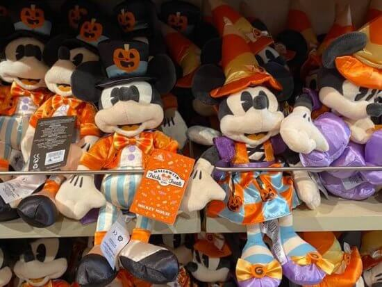 Mickey and Minnie Halloween plushes on a shelf