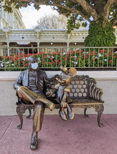 Roy Disney statue wearing a face masks, Magic Kingdom