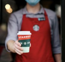 starbucks barista with red cup