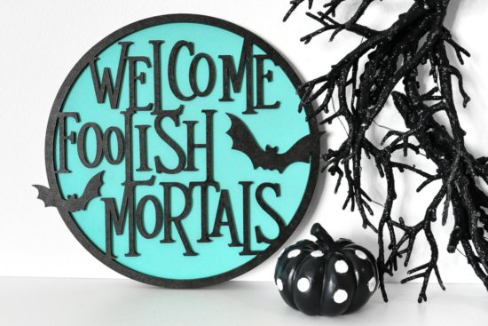 Welcome Foolish Mortals sign