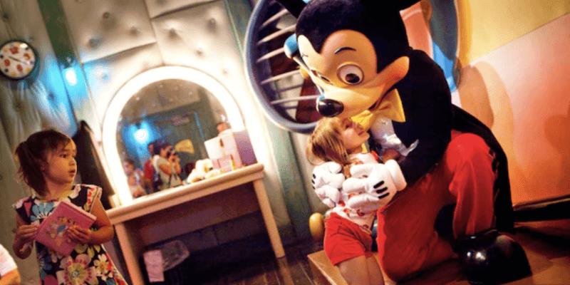 mickey hugging little girl disneyland