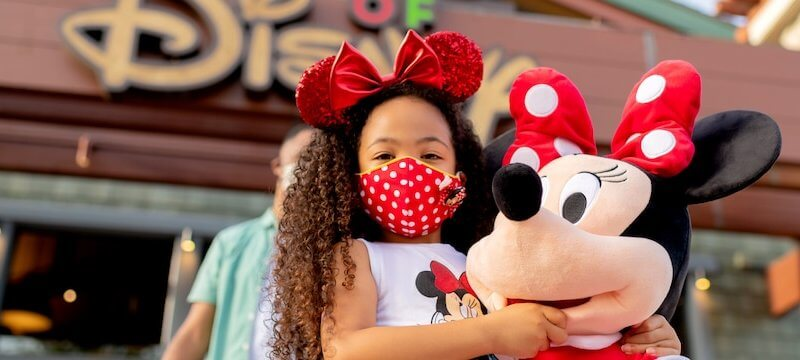 young girl wearing minnie mouse mask downtown disney