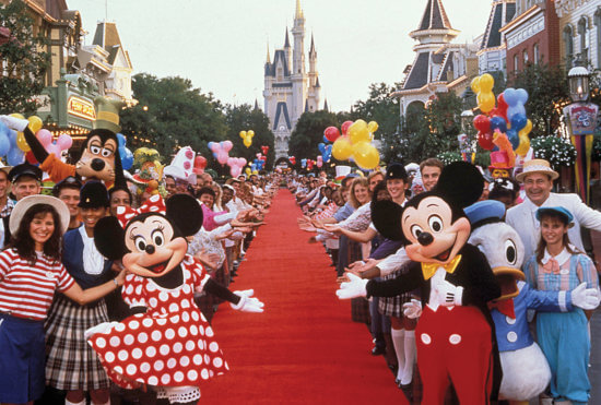 characters and cast members on main street usa at disney world