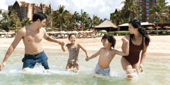 aulani family in water