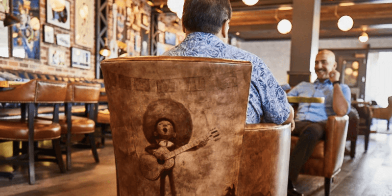 two men dining at lamplight lounge on pixar pier