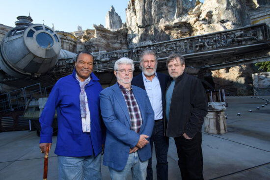 billy dee williams, george lucas, harrison ford, and mark hamill with millennium falcon at disneyland