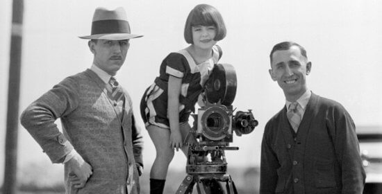 walt and roy disney with camera