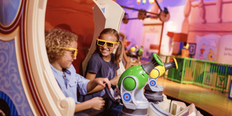 boy and girl riding toy story midway mania