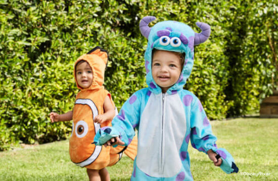 children dressed in pixar costumes as nemo and sulley