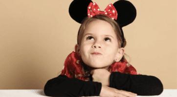little girl wearing polka dot minnie ears
