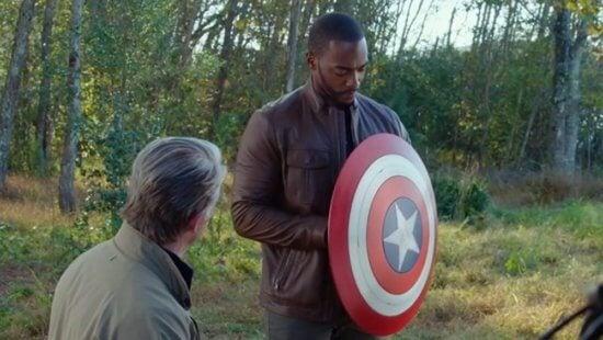 steve rogers giving sam wilson captain america's shield