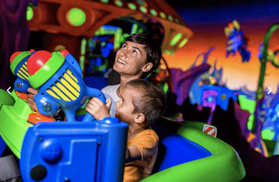 two boys on buzz lightyear's space ranger spin