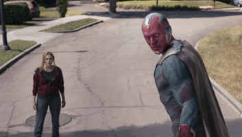 vision flying while wanda stands below